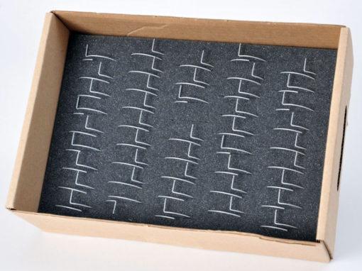 Mousse pour calage ressorts et antennes dans un emballage carton