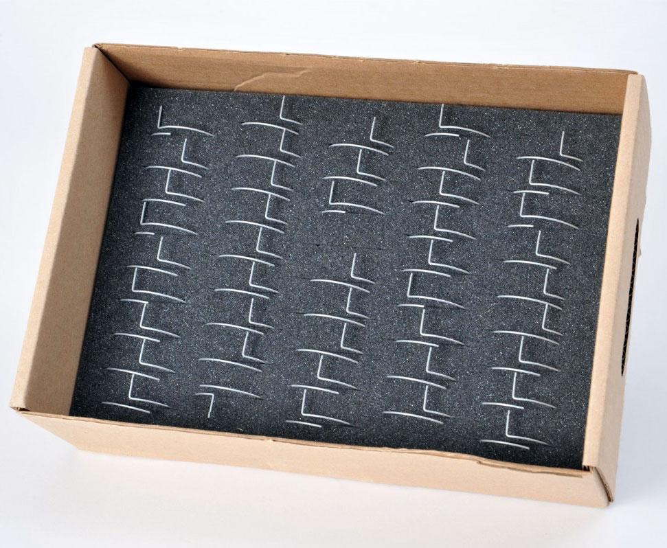 Mousse pour calage ressort dans emballage carton